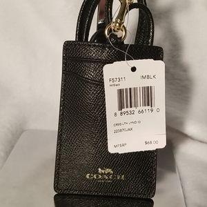 Coach black textured leather lanyard